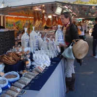 Mary buying salt guerande at the local french market | Cookery Courses in France
